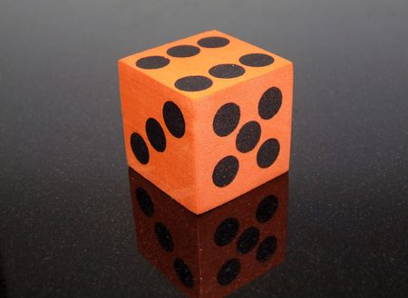 a bright orange die for playing games