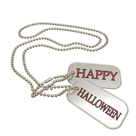 a set of dog tags saying happy halloween