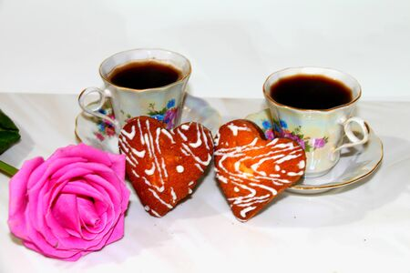 heartfelt: Coffee with biscuits. Coffee with cookies in the form of hearts, lying next to a rose flower. To drink coffee together and carry on a spiritual conversation is so romantic!