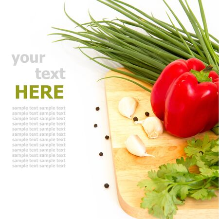 Cutting board and vegetable  isolated on white background photo