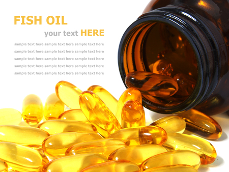 Pile of omega 3 fish oil capsules spilling out of a bottle photo