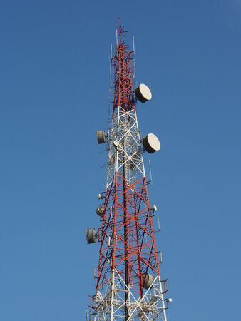 telecommunications tower with a clear blue sky photo