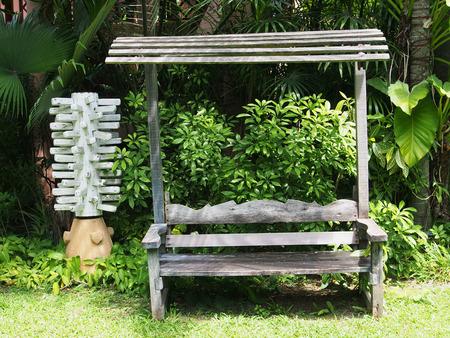 Brown wooden bench, wooden chair in the garden photo