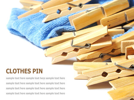laundered: Wooden clothes pin and laundered denim fabric isolated on white background