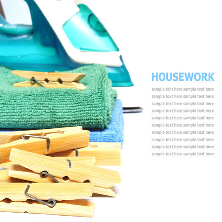 laundered: Wooden clothes pin and iron laundered fabric isolated on white background