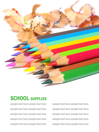 art school: school supplies color pencils shavings isolated on white background
