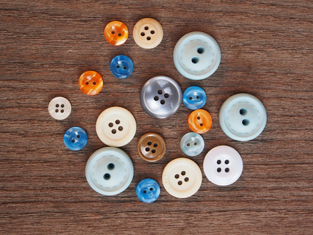 Group of buttons on the wooden table photo