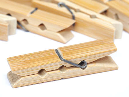 Wooden clothes pin isolated on white background photo