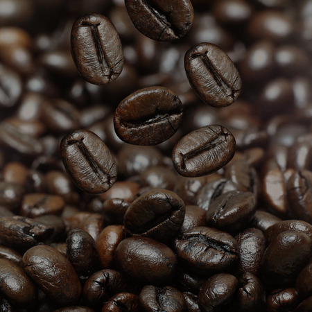 falling down: Coffee beans is falling down Stock Photo