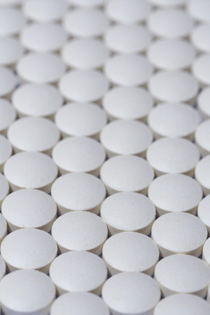 ecstasy pill: Close up of white pills Stock Photo
