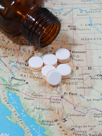 drug discovery: Medicine pills and map for travel