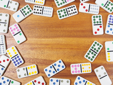 dominoes: dominoes on wooden background Stock Photo