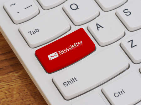 leadership key: Computer keyboard button with newsletter text