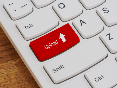 leadership key: Computer keyboard button with upload text