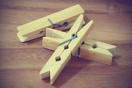 pegs: wooden cloth pegs on wooden background