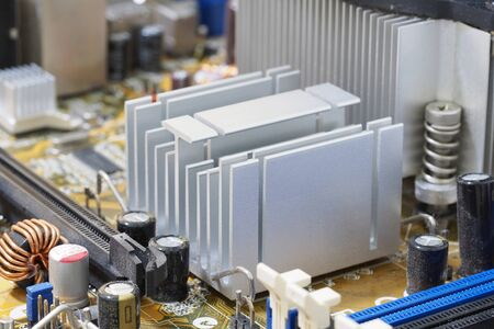 mainboard: Heatsink on the mainboard for reduce temperature of microchip Stock Photo