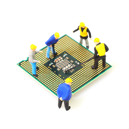 Group of engineer workers are repairing CPU (Central Processing Unit) on mainboard isolated on whute background.