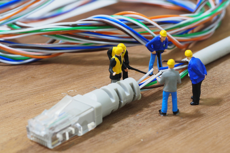 lan connection: Group of engineer workers are repair LAN network connection Ethernet RJ45 cable