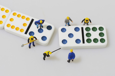 Group of engineer workers are making dominos Stock Photo - 65255330