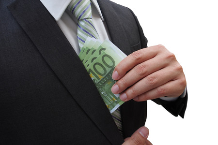 corruptible: Businessman putting euro banknotes in suit pocket isolated on white background, bribe and corruption concept.