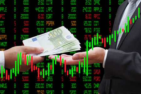 Investor giving euro money to his business partner, under Candlestick Chart, investment concept
