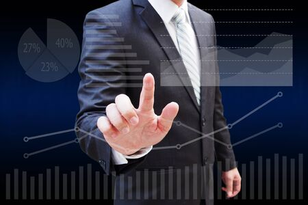 Businessman hand touching virtual panel of pir chart and other chart , business concept
