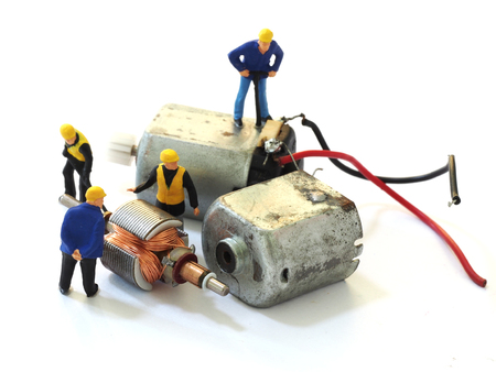 Group of engineer workers are repairing Small electric isolated on white background Stock Photo