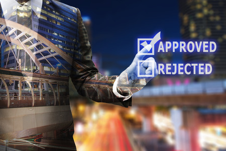 Business man hand touching virtual panel of checked check box of approved or rejected , business concept Stock Photo