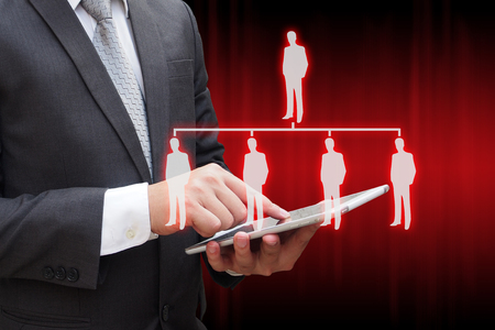 Businessman touching modern tablet with virtual panel of professional officer , human resources  concept