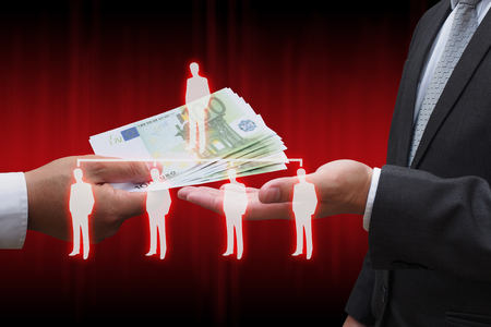 businessman giving euro money to his business partner with virtual panel of professional officer , human resources  concept
