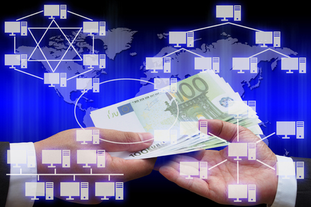network topology: businessman giving euro money to his business partner with virtual panel of virtual panel of computer network topology Stock Photo