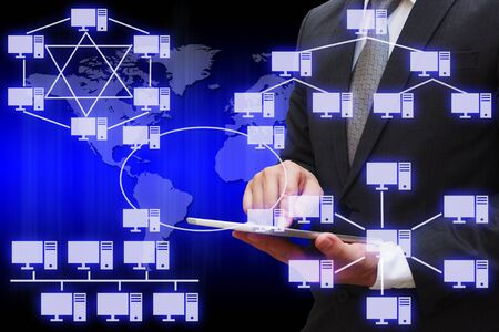 network topology: Business Man touching modern tablet with virtual panel of virtual panel of computer network topology Stock Photo