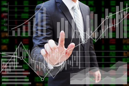 Businessman hand touching virtual panel of pie chart and other chart , business concept Imagens