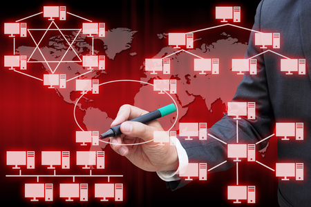 network topology: Businessman drawing the virtual panel of virtual panel of computer network topology Stock Photo