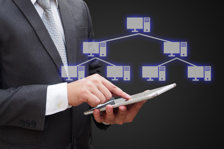 network topology: Businessman touching modern tablet with virtual panel of tree topology , Computer network technology concept
