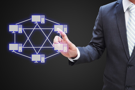 network topology: Businessman hand touching virtual panel of mesh topology , Computer network technology concept