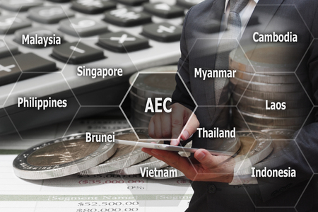 Double Exposure Businessman touching modern tablet with virtual panel of AEC (Asean Economics Community) , Business concept Standard-Bild