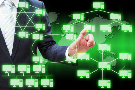 Businessman hand touching virtual panel of virtual panel of computer network topology