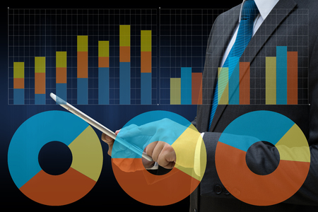 Business Man touching modern tablet with the virtual panel of pie chart and other chart , business concept