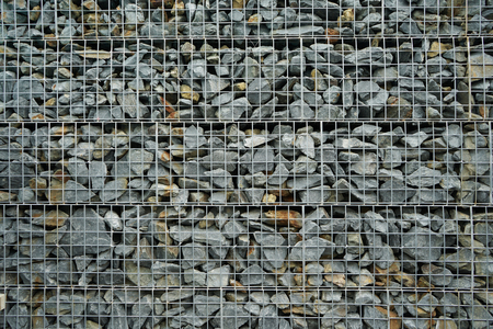 Pattern of modern style wall made from gray stone, design decorative concept