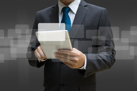 Business Man touching modern tablet with the virtual panel of round rectangle interface, business concept Lizenzfreie Bilder