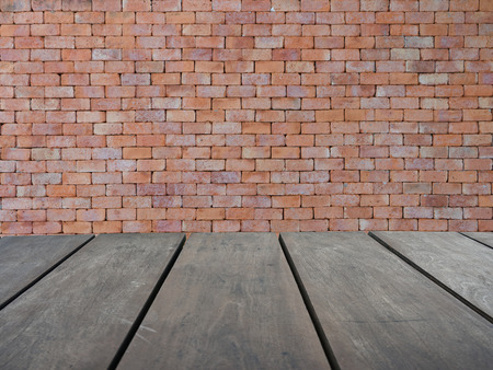 Empty top wooden shelves and red brick wall background