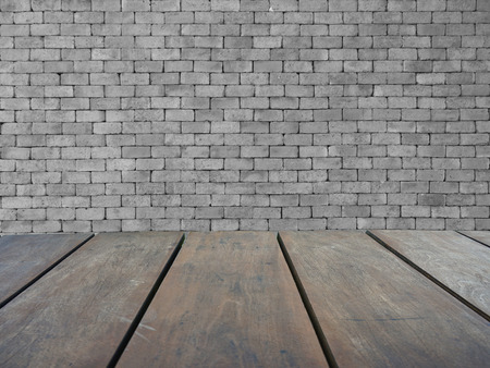Empty top wooden shelves and gray brick wall background Lizenzfreie Bilder