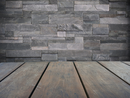 Empty top wooden shelves and modern gray brick wall background Lizenzfreie Bilder