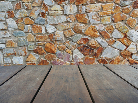 Empty top wooden shelves and stone wall background Lizenzfreie Bilder