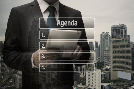 Double exposure businessman hand using digital tablet with virtual panel of agenda list Standard-Bild - 90283186