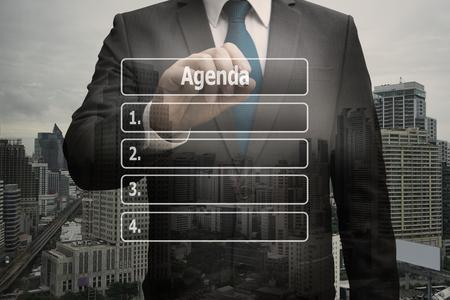 Double exposure businessman hand touching virtual panel of agenda list