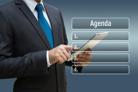 Businessman hand using digital tablet with virtual panel of agenda list