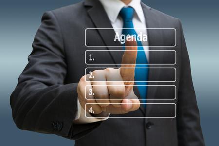 Businessman CEO hand touching  virtual panel of agenda list Standard-Bild - 90783113