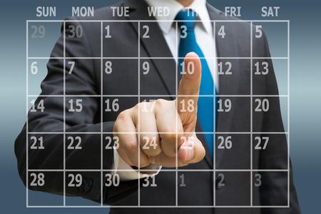 Businessman CEO hand touching  virtual panel of calendar planner